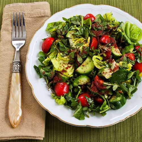 Mediterranean lettuce salad with purslane, mint, tomatoes, cucumbers ...
