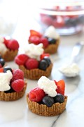 Mixed berry tartlet with dark chocolate and vanilla whipped cream