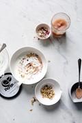 Noosa yogurt with granola and quince applesauce