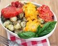 Oil-poached tomatoes over pesto gnocchi