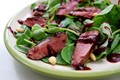Pan fried wood pigeon salad with a fresh raspberry balsamic reduction
