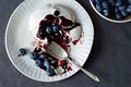 Pavlova with boozy blueberry sauce