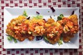 Plantain fritters with stewed shrimp (Tostones con camarones guisados)