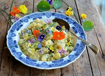 Provençal potato salad with truffle oil and edible flowers