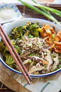 Quinoa bowl with kimchi, miso mushrooms, and crispy broccoli
