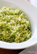 Raw shredded Brussels sprouts with lemon and oil