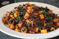 Red quinoa salad with butternut squash and spinach