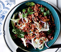 Red rice salad with pecans, fennel, and herbs