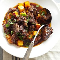 Rich beef stew with bacon and plums