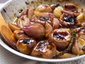 Roasted shallots with buttery sweet-tart glaze