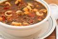 Roasted tomato soup with ground beef, sausage, garbanzos, macaroni, and basil