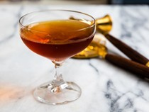 Rum, Scotch, and Cynar cocktail (100-year-old cigar)