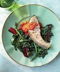 Salmon steaks with Swiss chard, asparagus, and almond-red pepper sauce