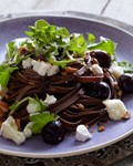 Savory chocolate pasta with bucherondin, hazelnuts, and cherries
