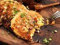Scrambled eggs with sumac, pine nuts, and parsley