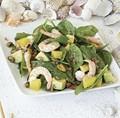 Shrimp and spinach salad with orange, avocado, and pistachios