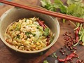 Sichuan shirataki sesame noodle salad with cucumber, sichuan peppercorn, chili oil, and peanuts