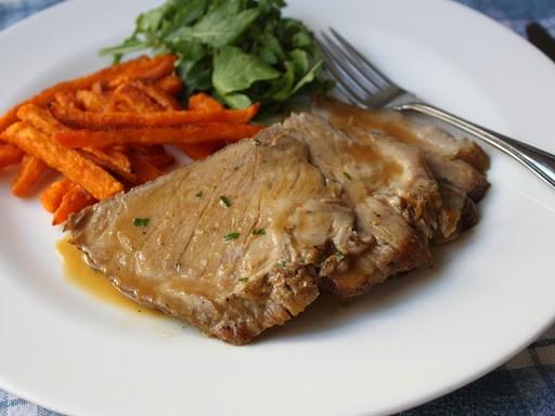 Slow cooker braised pork shoulder roast with apple butter sauce