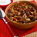 Slow cooker recipe for spicy ground beef and bean soup with cabbage and spinach