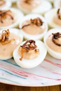 Smoky deviled eggs with Greek yogurt & frizzled shallots