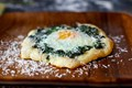 Spinach and egg pizzettes
