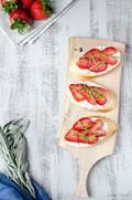 Strawberry ricotta crostini with basil, mint and sage