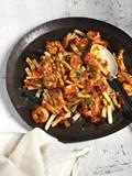Strozzapreti with king prawns, minced calamari, tomato, Taggiasche olives and chilli