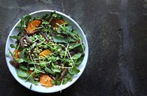 Tangerine arugula salad with lightly pickled dates and pepitas