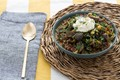 Vadouvan chickpea & collard green stew with purple potatoes & red quinoa