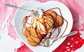 Vanilla ice cream with salt caramel sauce and heart biscuits