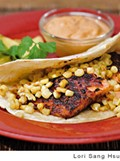 Wild salmon tacos with roasted corn and chile adobo cream