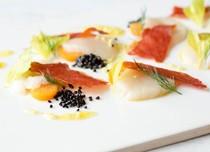 Yuzu-marinated scallops with kumquats and prosciutto